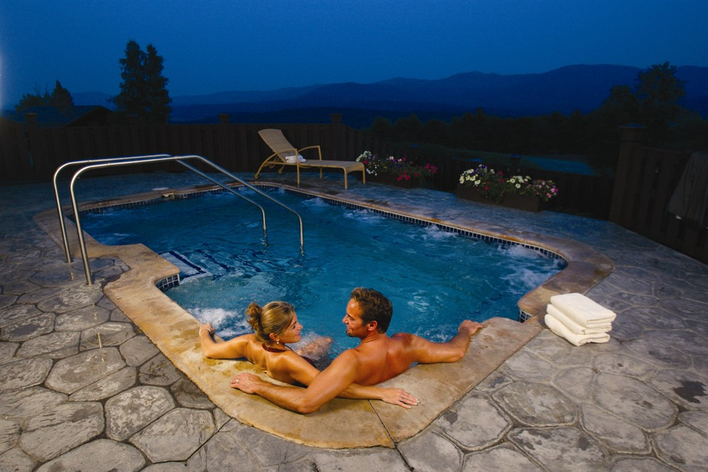 outdoor hot tub in the winter at Trapp Family Lodge